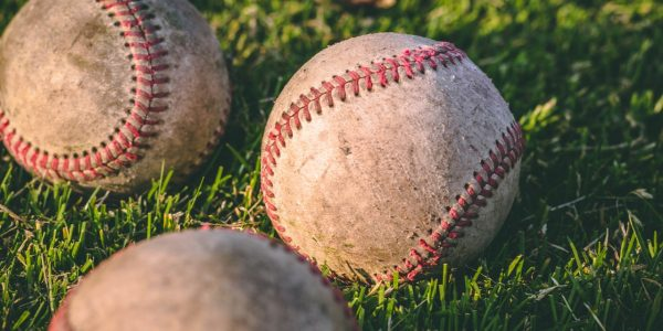 close-up-photography-of-four-baseballs-on-green-lawn-grasses-1308713 (1)